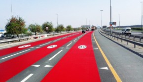 rak-road-painted-in-red-color-to-highlight-speed-limit